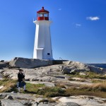 Bagpipe player at Peggy Cove Lighthouse in Canada