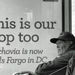 Three men sitting at bus stop in DC
